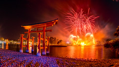 Epcot - Reflecting on Fire (Jeff Krause Photography) Tags: disney earth epcot fire fireworks gate illuminations japan lagoon park reflections rocks sse shore torii wdw theme baylake florida unitedstates us fisheye