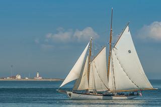 Schooner Zodiac and Point Wilson Lighthouse Sailing