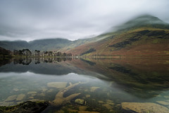 calm at buttermere (akh1981) Tags: mountains manfrotto moody nikon nisi cumbria clouds calm travel trees tranquil wideangle walking buttermere landscape lakedistrict lake longexposure rocks reflections