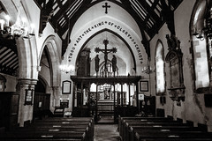 There Are No Atheists In Foxholes (NVOXVII) Tags: church religion chrsitianity christ crucifix architecure lofi grain beautiful bnw monochrome blackandwhite nikon hampshire chawton pews altar