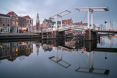 Double Vision (McQuaide Photography) Tags: haarlem noordholland northholland netherlands nederland holland dutch europe sony a7rii ilce7rm2 alpha mirrorless 1635mm sonyzeiss zeiss variotessar fullframe mcquaidephotography lightroom adobe photoshop tripod manfrotto light licht water reflection stad city urban waterside lowlight architecture outdoor outside waterfront building river spaarne riverside traditional authentic skyline house houses huis huizen residential longexposure calm still nopeople old oldhouse dutcharchitecture bulbmode ndfilter neutraldensity bwfilters gravestenenbrug drawbridge ophaalbrug brug bridge