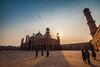 Badshahi Mosque (imtiazchaudhry) Tags: sunset sun skies mosque minarets floor courtyard people pray worship