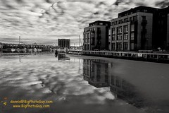 Deep reflections among ice patches on a magnificent day at Fells Point. (PoppedyPics) Tags: baltimorecounty blackandwhite fellspoint maryland nearwater pier reflection sail water winter bw blackwhite ocean
