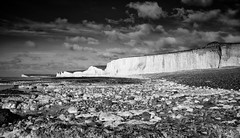 The Seven Sisters (Lloyd Austin) Tags: bw nikon d7200 sigma1750mm monochrome mono bnw blackandwhite england nature clouds sky cloudscape landscape seascape lowtide cliffs chalk pebbles stones beach water sea englishchannel shoreline coastline coastal southernengland nationaltrust nationalpark southdowns cuckmerehaven seaford eastbourne beachyhead birlinggap thesevensisters