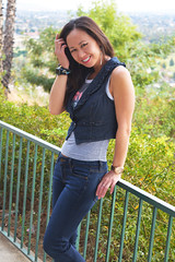In Jeans on the Railing (Lexmax08) Tags: asian vietnamese woman female model sexy beautiful vista view mountain rail smile jeans vest watch hair arms bare