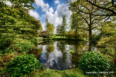 The Gardens at Wightwick Manor. (Holfo) Tags: nationaltrust wightwickmanor gardens lake hdr nikon d750 clouds trees bushes reflections tree wood sky grass landscape