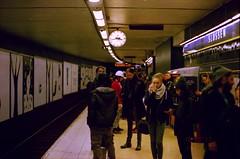 white helmet under 15:43 on the platform in the slussen station (Mister.Marken) Tags: expiredfilm nikonnikkor 50mm nikonfg digibasec41 subway people crowd helmet slussen nikonnikkor50mm extrafilmcom madeinsweden
