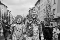 Mainz Street Rosenmontag 2 Clowns b&w (rainerneumann831) Tags: bw blackwhite street streetscene ©rainerneumann urban monochrome candid city streetphotography blackandwhite mann frau clown mainz rosenmontag