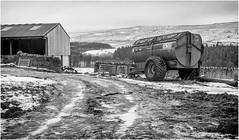 Holwick . (wayman2011) Tags: f2 fujifilmxf35mm lightroomfujifilmxpro1 wayman2011 bwlandscapes mono rural farms farmmachinery winter snow pennines dales teesdale holwick countydurham uk