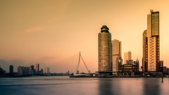 Rotterdam skyline (hboudeling) Tags: rotterdam zuidholland netherlands nl the holland golden hour architecture hotelnewyork hollandamerikalijn kopvanzuid maas erasmusbrug erasmusbridge goldenhour city skyline longexposure