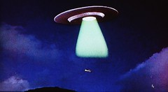 """A beam engulfs the plane and draws it into the spaceship in """"This Island Earth"""" (1955) (lhboudreau) Tags: fiction sciencefiction sciencefictionstory 1955 story film movie motionpicture classicsciencefiction vintage classic scifi scififilm scifimovie universal universalpicture universalstudios universalpictures screenshot sciencefictionfilm sciencefictionmovie spaceship ufo flyingsaucer beam lightbeam greenlight plane lightplane sky nightsky calmeacham rexreason exeter jeffmorow jackarnold josephmnewman thisislandearth islandearth franklincoen edwardgocallaghan faithdomergue ruthadams lightaircraft stinson108 specialeffects sfx visualeffects vfx"""