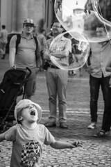 Happiness (Cristiano Drago) Tags: cristianodrago canon 650d italia itlay roma rome biancoenero blackandwhite blackwhite black grey grigio kid kids bambini bambino bimbi bimbo piazza square piazzadelpopolo popolo bolla bolle soap soapball ball balls hat cappello kidhat bambinocappello bianco trip