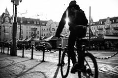 Ride with Flair 136.365 (ewitsoe) Tags: ride bike ewitsoe monochrome flare flair bnw blackandwhite city sidewalk cityscape urban jezyce poznan poalnd canon eos6dii 50mm 12f