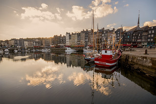 the sun will soon set on the boats and buildings of the old and picturesque harbour, the Vieux Bassin, Honfleur, Calvados, Normandy, France