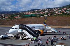 Our plane home (Steenjep) Tags: madeira portugal ferie holiday urlaub funchalairport airplane airfield runway truck landscape sky thomascookairlines thomascook airbus a321 oytcd