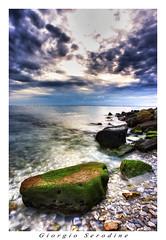 HDR scogliera aurisina (Giorgio Serodine) Tags: scogliera massi mare golfo trieste italia nubi hdr sassi muschio vongole controluce canon grandangolo lungaesposizione allaperto calma tramonto riflessi