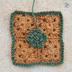 The same crochet square with a crochet flower to add a decorative element (crochetbug13) Tags: crochetbug crochet crocheted crocheting crochetsquares crochetflowers grannysquares projectamigo flower