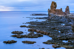 Broken Headland (John Fÿn Photography) Tags: blue building buildings calm iceland lighthouse longexposure nordic republicoficeland sea water current headland ocean rock saltwater surf tranquil waves west is