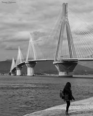 Rio Patras - Bridge (couvanos) Tags: february sea blogger traveling nikon capture woman travel morning monday greece weather clouds sky archi architecture patras rio bridge white black bnw