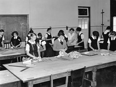 State High School, Domestic Science, Dressmaking - Brisbane (Queensland State Archives) Tags: people girls students dressmaking domesticscience teachers teaching education secondary statehighschool brisbane fabric desk classroom queenslandstatearchives history record archives qld