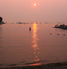 paddling home (n.a.) Tags: kayak sunset beach vancouver bc canada orange haze girl people