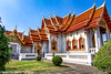 """Wat Benchamabophit (The Marble Temple) Bangkok Thailand-17 (Yasu Torigoe) Tags: watbenchamabophitdusitvanaramwhichmeans""""themonasteryo bangkok krungthepmahanakhon thailand th wat benchamabophit dusitvanaram which means """"the monastery fifth king near dusit palace"""" is buddhist temple district it known marble one bangkoks bestknown temples major tourist attraction typifies ornate style high gables with steppedout roofs elaborate finials construction began 1899 built italian the cloister around assembly hall houses 52 images buddha"""