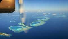Seaplane over the Maldives. (Tony Smith Photo's) Tags: flight paradise ocean island travel vacation sky tropical beach blue sea plane summer water beautiful transport holiday resort airplane exotic luxury aircraft fly lagoon journey tourism air aerial turquoise idyllic seaplane palm tree indian view passenger sand hydroplane leisure tourist atoll coast aviation propeller seascape scenic float destination clear floatplane engine airline beauty coastline flying maldives idyll fantastic window cloud