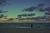 Memories of moon rise (beyondhue) Tags: miami beach sunset moon rise beyondhue florida woman walk waves ocean windy cloud sky winter usa travel sand