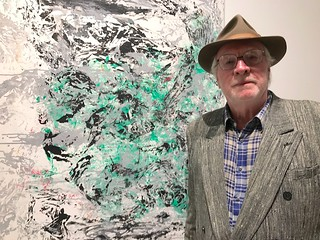 Artist Robert deYoung with his art at LnS Gallery