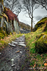 Quarry Barracks Snowdonia (Adrian Evans Photography) Tags: track moss snowdonia winter textured wales dinorwigquarry uk northwales quarry architecture footpath stone path snowdonianationalpark llanberis landmark buildings outdoor slate clouds angleseybarracks abandoned barracks ruins adrianevans weathered dilapidated dinorwicquarry decay tree trail sky british