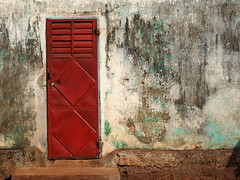Red Door with Louvres (Drew Makepeace) Tags: guinea door wall