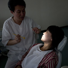 North Korean dentist and his patient in an hospital, Pyongan Province, Pyongyang, North Korea (Eric Lafforgue) Tags: adults adultsonly asia care checking communism dentalexplorer dentalhygiene dentist dentistschair dictatorship doctor dprk dprk0389 female health healthcare healthcareandmedicine humanbeing indoors inspection man medicalexamination medicine men northkorea patient people pyongyang squarepicture twopeople waistup woman women pyonganprovince 北朝鮮 북한 朝鮮民主主義人民共和国 조선 coreadelnorte coréedunord coréiadonorte coreiadonorte 조선민주주의인민공화국 เกาหลีเหนือ קוריאההצפונית koreapółnocna koreautara kuzeykore nordkorea північнакорея севернакореја севернакорея severníkorea βόρειακορέα