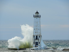 Great Lakes Splash! (JamesEyeViewPhotography) Tags: lake michigan frankfort lighthouse water waves splash ice winter sky clouds wind northernmichigan landscape lakemichigan greatlakes nature january jameseyeviewphotography