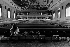 A Tightness in the Chest (sadandbeautiful (Sarah)) Tags: me woman female self selfportrait auditorium bw abandoned