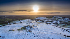 Loughcrew - the white cairns (mythicalireland) Tags: loughcrew sliabh slieve na calliagh cairns cairn monuments megalithic neolithic stone age sun sunset halo white snow snowy winter wintry drone dji phantom 3 advanced meath landscape ireland