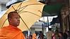 Monk With Parasol (CAMBODIA) (ID Hearn Mackinnon) Tags: buddhist buddhism buddha monk cambodia cambodian phnom penh 2017 south east asia asian man people culture society religious religion parasol umbrella orange robe street city urban