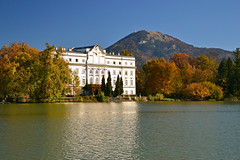 Schloss Leopoldskron in autumn (echumachenco) Tags: schloss palace leopoldskron salzburg austria österreich lake pond water reflection tree forest autumn fall autumncolors mountain mountainside gaisberg sky blue landscape outdoor serene rokoko architecture history art nikond3100 building park