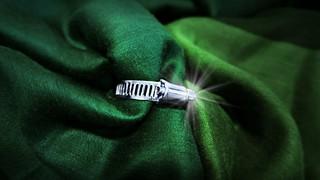 Fastener green silk scarf.