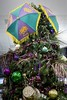 top of a Mardi Gras Christmas tree decorated with purple (justice), green (faith), gold (power) ornaments in the Mobile, Alabama Regional Airport. (thstrand) Tags: us usa unitedstates south alabama mobile winter umbrellas umbrella traveldestination traditional traditions tradition tourism symbols symbol display seasonal season religious religion purplegoldgreencolors public pinetrees ornamental ornaments ornament nobody christmastree mardigras lobby american lent indoors holidays holiday festive festival fattuesday epiphany decorativedisplay decorations decoration decorated customs custom culture culturalheritage colorful christian celebrations carnival brightcolors annualcelebtration airport