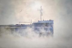 Sees Through The Fog (karenhunnicutt) Tags: ship rogerblaylock seasmoke port lakesuperior twoharbors minnesota extremecold fog karenhunnicuttphotography winter northshore