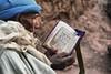 lalibela (Neal J.Wilson) Tags: reading bible religion man lalibela ethiopia ethiopian africa african words travelling old nikon