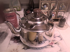 New Tea Kettle (jolee-mer) Tags: teakettle stainlesssteel new counter containers hotpad vintagelook peppermill guittardcocoa spicebox brandy dates cuttingboard reflections