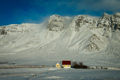 Peaceful setting for an Icelandic home (Winniepix) Tags: 2018 iceland travel winniepix house no nopeople red yellow blue cloud snow wind frozen cold winter holiday live home mountain