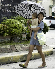 Proud Mother (Beegee49) Tags: street mother carrying baby child umbrella smiling filipina bacolod city philippines