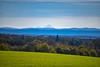 Mont Blanc far away (jmarnaud) Tags: france jura 2017 poligny countryside windmill cow blue sky walk green mont blanc