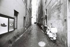 Roma (goodfella2459) Tags: nikon f4 af nikkor 24mm f28d lens fomapan profiline action 400 35mm blackandwhite film analog roma city italy street rome bike buildings road streets bwfp manilovefilm