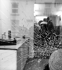 Glass splinters (Hammerhead27) Tags: damage smashed reflection urban monochrome bnw bw blackandwhite splinter star vandalism street shop glass windows broken somerset wellington iphone