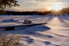 The Setting Sun (Lindaw9) Tags: dock bench snow lake sun set treeline snowdesigns