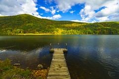 Amherst Lake Autumn Pier (RobertCross1 (off and on)) Tags: a7rii alpha amherstlake emount fe1635mmf4zaoss greenmountains ilce7rm2 ludlow newengland plymouth sony vt vermont autumn bluesky boat clouds dock fall fishing foliage forest fullframe lake landscape leaves mirrorless pier reflection trees water wideangle