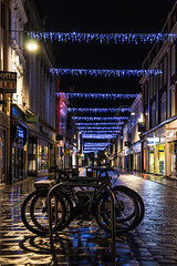 Whitefriargate Reflections (SydPix) Tags: whitefriargate hull kingstonuponhull night reflections wet bike bicycle silhouette street pavement christmas lights illuminations shops retail store sydyoung sydpix